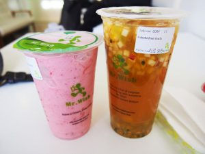 A strawberry sherbet smoothie (left) and colorful fruit tea from Mr. Wish, a popular bubble tea shop on Middle Neck Road in Great Neck. Having opened at the end of 2017, Mr. Wish is often compared to Vivi Bubble Tea, a nearby bubble tea shop that opened in 2016.