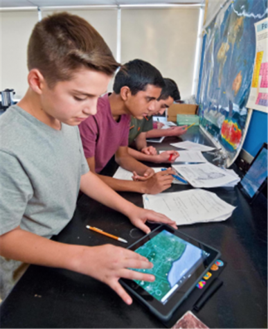 Ipads, though controversial, indeed have a positive effect on our school. (Image Source: GNPS)