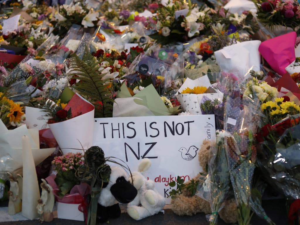 A memorial near Al Noor Mosque for victims of the shooting. The memorial advocates for unity against hatred and racism, while also remembering the victims. [Photo Credit: Associated Press]