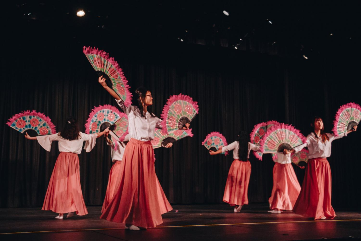 Performers dance using colorful fans in the Korean fan act. Performances like the Korean fan dance celebrate traditional aspects of Asian cultures in North High's Asian Culture Night. (Credit: Joanna Chung)