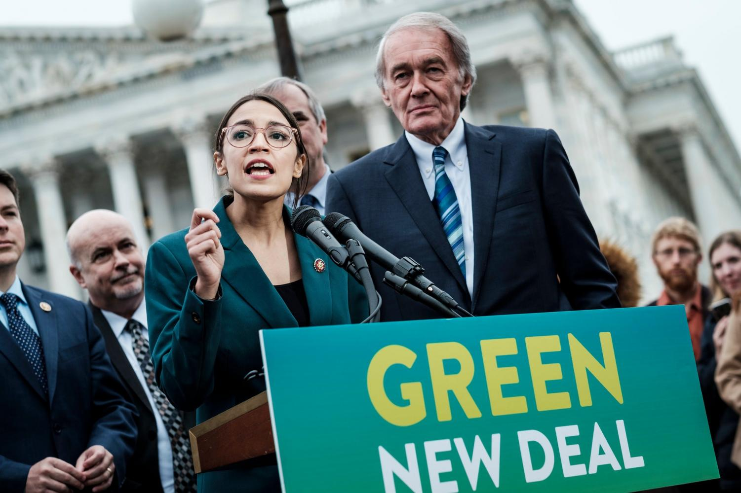 Ocasio and Markey announcing The Green New deal at a press conference(Credit:The New York Times)