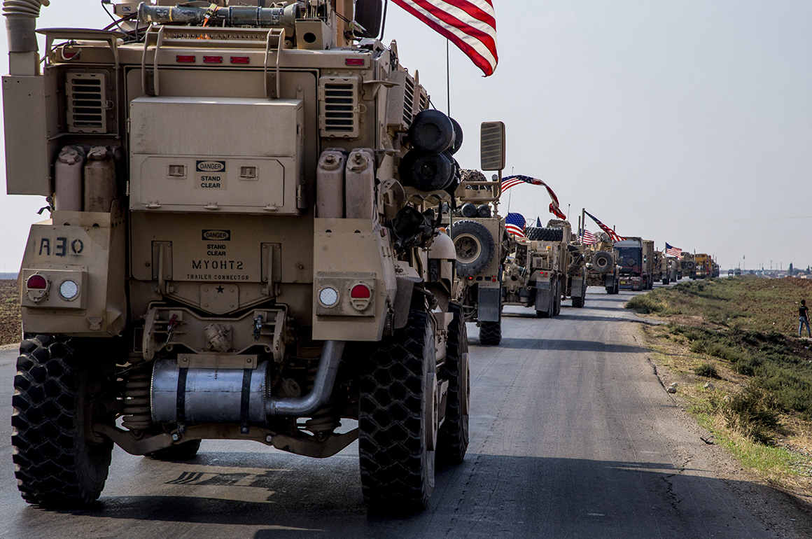 U.S. military convoys drive near the town of Qamishli in northern Syria. The vehicles head south, likely heading to the oil-rich Deir el-Zour region or another base nearby (AP Photo/Baderkhan Ahmad).