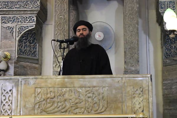 One of the very few images ever taken of the Baghdadi, as he is giving a speech.