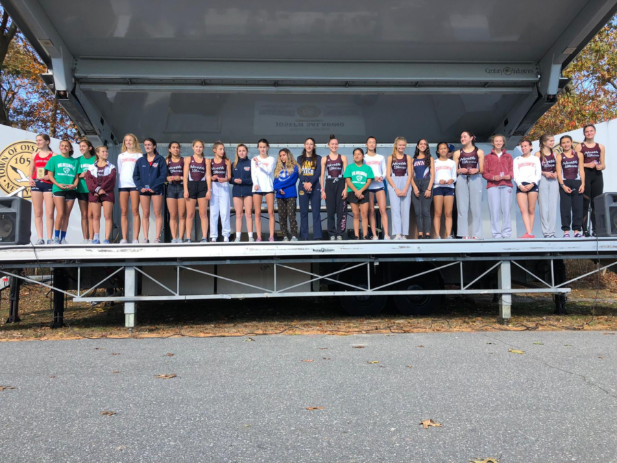 The top 25 finalists who received all counties recognition, with Alexandra Ahdoot, a team member of the North High School Girls Cross Country team, who placed 18th.