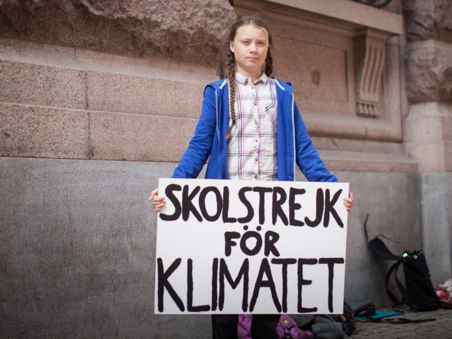 Greta Thunberg stands in front of the Swedish Parliament. Thunberg began her school strike on August 20, 2018. (Photo Credit: businessinsider.com)