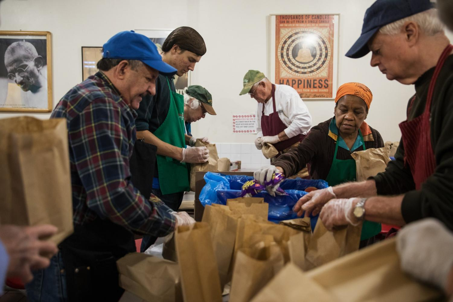 Volunteers preparing meals at a soup kitchen in Brooklyn. (Credit: Todd Heisler/The New York Times)