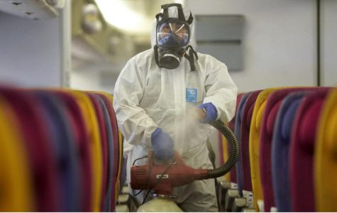 A member of the Thai Airways Crew disinfects an airplane cabin in defense against the spread of Coronavirus. Credit: Business Insider.
