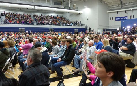 Democratic caucus goers sitting in a local gym before the first round of voting. [Photo credit: Flickr]