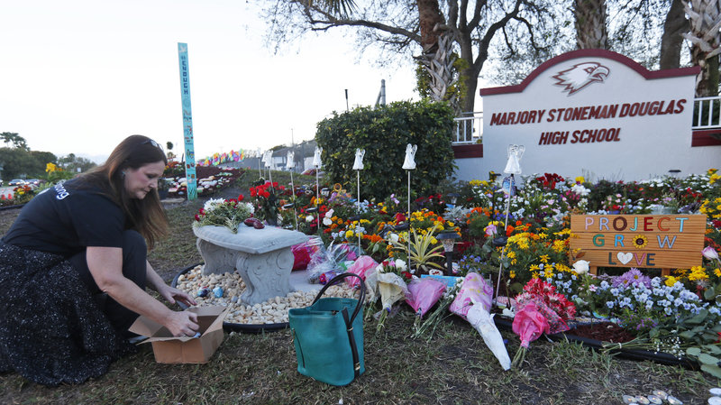 One+of+many+memorials+to+the+lives+lost+in+the+mass+shooting+that+took+place+at+Marjory+Stoneman+Douglas+High+School.+%5BPhoto+credit%3A+NPR%5D