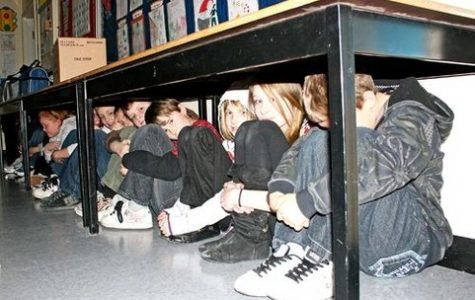 Students hiding under desks as part of a lockdown drill. (Photo credit: Ohio Education Association)