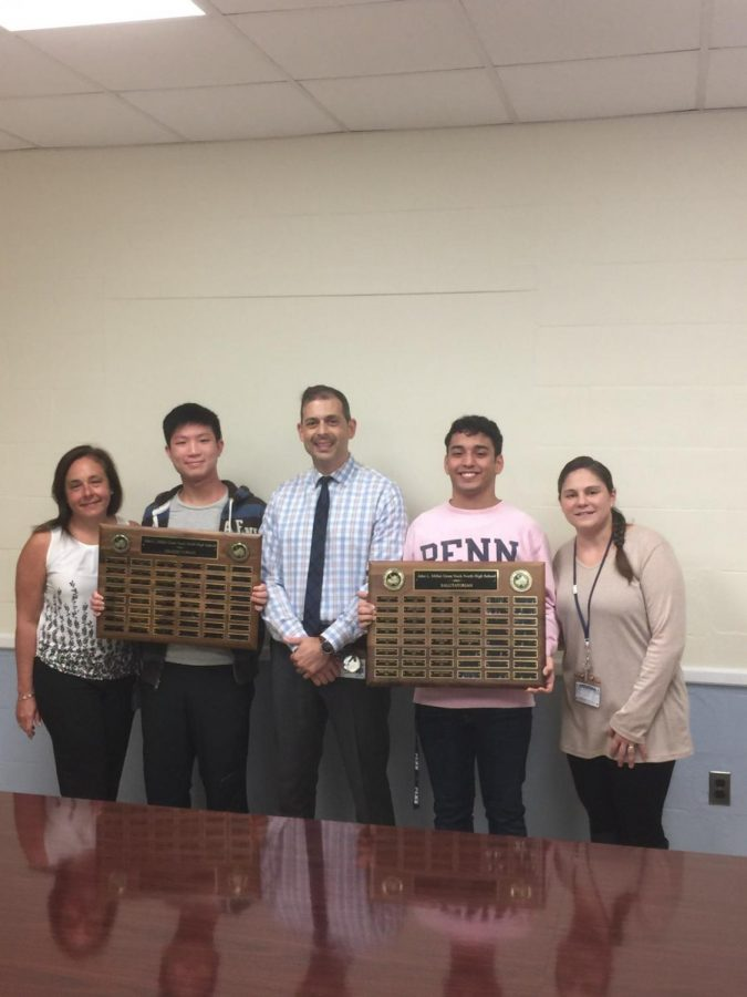 Raymond Lin (Valedictorian) and Judah Nouriyelian (Salutatorian) hold their engraved plaques with members of Great Neck North faculty.