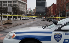 Large portions of the roads surrounding the Federal Building were closed off, barring civilian access. Following reports of a suspicious package, numerous streets around the building were placed under lockdown. (Credit: Democrat & Chronicle)