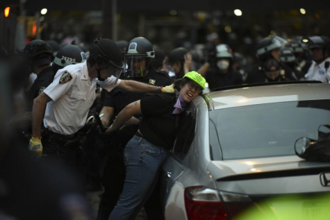 NYPD cops detain legal observer at Bronx protest on June 4th (Photo credit: Human Rights Watch)