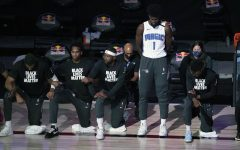 Magic forward Jonathon Isaac captured standing as the national anthem is recited. (Credit: Nba.com)