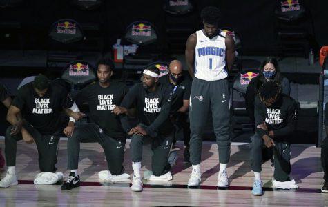 Magic forward Jonathon Isaac captured standing as the national anthem is recited. (Credit: Nba.com)