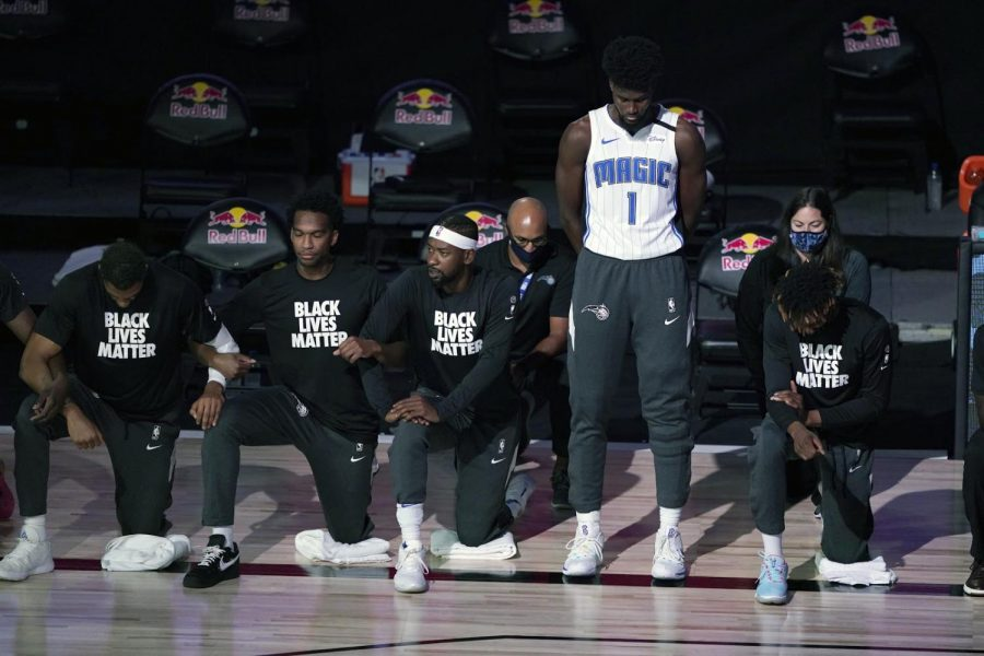 Magic+forward+Jonathon+Isaac+captured+standing+as+the+national+anthem+is+recited.+%28Credit%3A+Nba.com%29