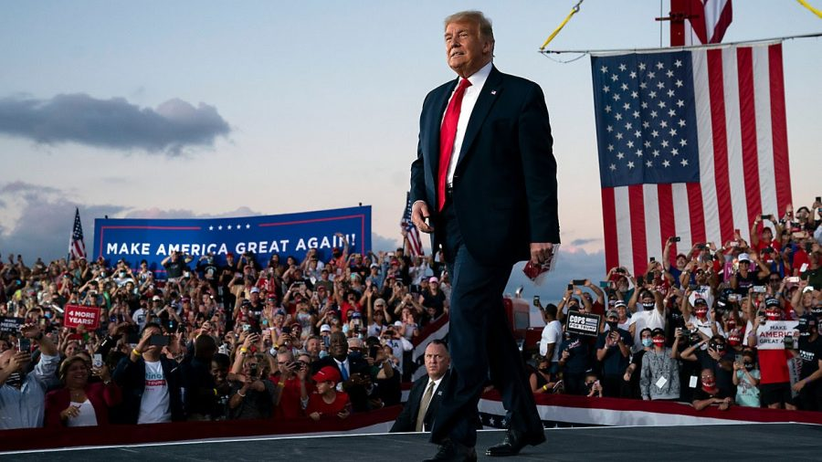 President Trump walks to the podium at his rally in Sanford, Florida on Oct. 12. Many of the participants, including the president, are not wearing masks. (Credit: Spectrum News 1)