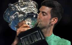 Novak Djokovic reigns supreme, defending the men's singles title at the 2021 Australian Open. (Credit: Mark Dadswell/AP)